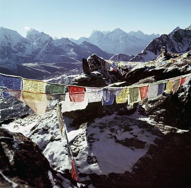 Prayer flags on top of summit Gokyo Ri